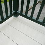 Decking with a dark green fence