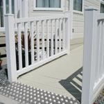 Decking with a white fence