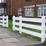 White pannel fence by house