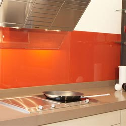 Look at the orange coloured splashback wall